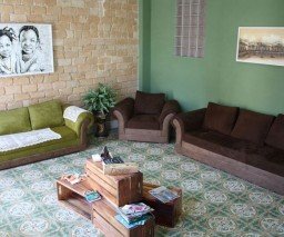 The front room at La Gargola Hostal in Old Havana, Cuba