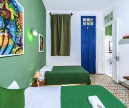 The Green room in La Gargola Hostal, Havana, Cuba