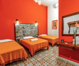 The Orange room in La Gargola guesthouse in Old Havana, Cuba