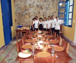 The friendly staff at La Gargola guesthouse in Old Havana, Cuba