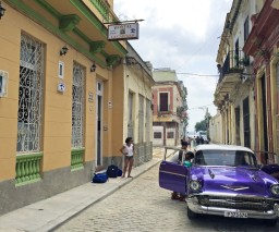 A guest arriving to Hostal La Caridad in Old Havana