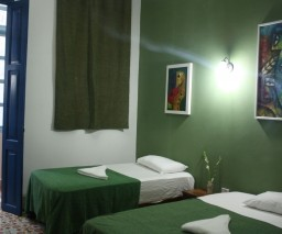The Green Room of La Gargola Hostal in Old Havana, Cuba