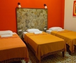 The Orange Room of La Gargola Hostal in Old Havana, Cuba