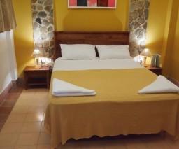 The Yellow Room in La Gargola guesthouse in Old Havana, Cuba